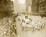 """The Dumont club carries its """"cape"""" along Broad Street at the 1929 Mummers' Parade"""