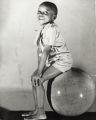 Burnis McCloud Jr. posing on globe