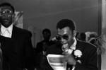 Black Muslim man speaking into a microphone