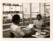 Two women in the Division of Welfare office across from the Pruitt-Igoe public housing project.