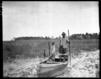 Mose Moultrie and boy in boat