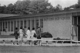 African American students entering Hueytown High School in Hueytown, Alabama, during the integration of the school.