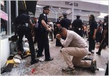 Man kneeling and praying at Five-Points MARTA station as part of the Atlanta protests after the announcement of the verdict acquitting Los Angeles Police Department officers in the videotaped assault on African American, Rodney King, Atlanta, Georgia, April 30, 1992