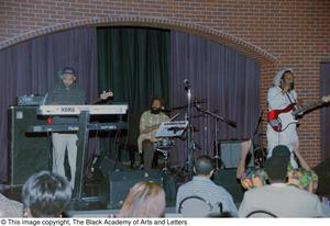 [Unknown reggae band performing on club stage] Reggae in the Caribbean