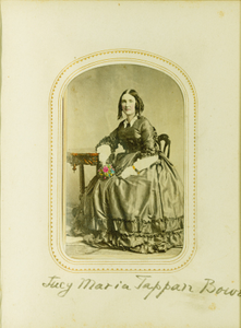 Studio portrait of Lucy Maria Tappan Bowen, seated, facing front, with flowers in one hand, location unknown