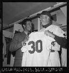 Walt Alston presents Maury Wills with Dodger uniform