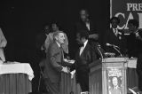 Vice President Walter Mondale shaking hands with a man at the annual King-Kennedy-Johnson dinner of the Alabama Democratic Conference in Montgomery, Alabama.