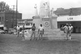 """Men standing around the Confederate monument in downtown Greenwood, Mississippi, during the """"March Against Fear"""" begun by James Meredith."""