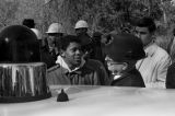 Police officer speaking speaking to Simuel Schutz, Jr., during a student demonstration in Tuskegee, Alabama, to protest the murder of Samuel L. Younge, a civil rights worker.