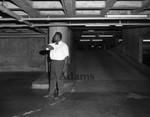 Parking attendant in garage, Los Angeles 1970