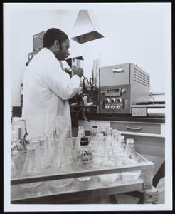 Wilson Walker at work in Ohio Department of Health Sanitary Chemistry Laboratory