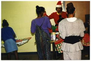 Women and Children at Gift Table During Christmas Party San Antonio Chapter of Links Records
