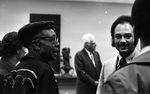 Jesse Fuller speaking with tv host and newsman Ray Taliaferro (right) after his concert at the Oakland Museum