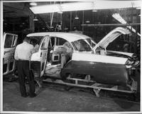 1955 Packard clipper on assembly line, left side view