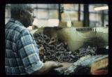Alfred Malone making tobacco twists