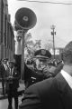 Officer R. M. Lane of the Atlanta Police Department using a bullhorn to direct the crowd outside Ebenezer Baptist Church on the day of Martin Luther King, Jr.'s funeral.