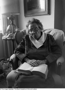 Photograph of Mable Chandler holding a book with a thumb index Dallas/Fort Worth Black Living Legends Dallas/Fort Worth Black Living Legends, 1992