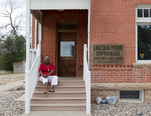 Museum chief executive director Ruth Steele, photographed on the steps of the chief executive director of the Dr. Martin Luther King Jr. Cultural Center and Museum in Pueblo, Colorado. The photo was taken in September 2015, one year before the museum, housed in a onetime orphanage, was closed and its artifacts placed in storage
