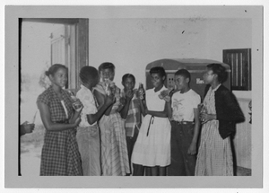 Photograph of African American students gathered around a Coca Cola machine, Manchester, Georgia, 1953