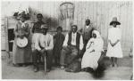"Left to right: Harriet Tubman; Gertie Davis [Tubman's adopted daughter]; Nelson Davis [Tubman's husband]; Lee Cheney; ""Pop"" Alexander; Walter Green; Sarah Parker [""Blind Auntie"" Parker] and Dora Stewart [granddaughter of Tubman's brother, John Stewart]"