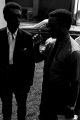 Norman Lumpkin, news director for WRMA radio in Montgomery, talking with Stokely Carmichael while standing in the yard in front of the Autauga County Improvement Association office in Prattville, Alabama.