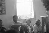 People seated by the window in a church building, probably First Baptist Church in Eutaw, Alabama.