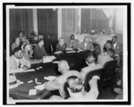 [Senate majority leader Ernest W. McFarland, Walter F. White, Clarence M. Mitchell, and others sitting around large table during civil rights conference in Washington, D.C., May 22, 1951]