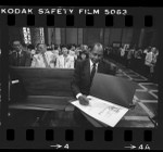 Los Angeles Mayor Tom Bradley signing proclamations for Japanese American World War II internees, 1984