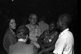 """People holding hands and singing at an evening gathering in Canton, Mississippi, during the """"March Against Fear"""" begun by James Meredith."""