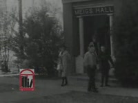 Series of WSB-TV newsfilm clips of African American student Charlayne Hunter walking on the campus of the University of Georgia in Athens, Georgia, 1961 January