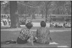 [Two women sitting on grass near the National Mall during the March on Washington, 1963]
