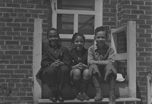 Herman, Anne, and Jack sitting on porch