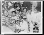 [Mrs. Bulah Melton, 29, widow of shotgun-victim Clinton Melton, with her four children, being interviewed at her Mississippi home by NAACP field secretary Medgar W. Evers]