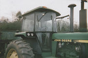 Elton Datcher, Jr., on a tractor on the family farm in Harpersville, Alabama.