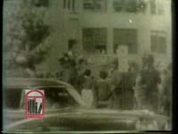 "WSB-TV newsfilm clip of African American students--the ""Little Rock Nine""--integrating Central High School and white students burning an effigy in protest in Little Rock, Arkansas, 1957 October 3"
