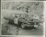 African American female on parade car