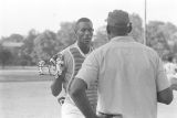 Umpire speaking to man during a boys' baseball game, probably in Montgomery, Alabama.