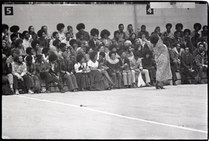 Huey P. Newton speaking at Boston College: audience member spontaneously warming up crowd