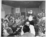 Male and female patrons at and near the bar, Slim Jenkins nightclub Oakland, California