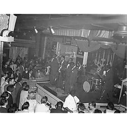 Seven piece jazz band performing at the Rock 'n Roll Club, with Christmas decorations