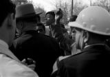 Students speaking to policemen who have lined up across Old Montgomery Road to block their demonstration in Tuskegee, Alabama, to protest the murder of Samuel L. Younge, a civil rights worker.