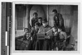 Father Carroll reads to group of Korean children, Anshu, Korea, ca. 1930-1939