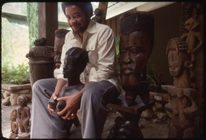 Bill Withers: Withers surrounded by African sculpture and cupping the breasts of a bust