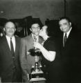 Virginia and Franklin Harlow with their son, Philip. Philip is seen receiving the 'Black Athlete of the Year' award given by the Grand Street Boys, a Syracuse community service organization of African American men which gave athletic awards to local high school students.