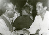 "Welton E. Barnett greets James """"Trummy"""" Young"