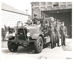 African American members of Oakland Fire Department engine company No. 22 pose with their engine in front of the fire house at 2230 Magnolia Street, Oakland, California