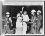 Police march two Negros from the Los Angeles Black Muslim Mosque after ... weeklong racial uprising had been declared ended