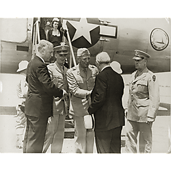 A civilian, possibly Mayor David L. Lawrence, greeting General Eisenhower beside an Air Force airplane