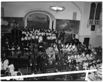 Church choir singing in front of group of masons