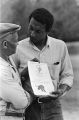 Stokely Carmichael of SNCC giving a man literature about the Lowndes County Freedom Organization in Lowndes, County, Alabama.